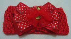 Faixa elastano co laço em fita e detalhe com rosa botão para deixar sua princesa linda. R$ 14,90