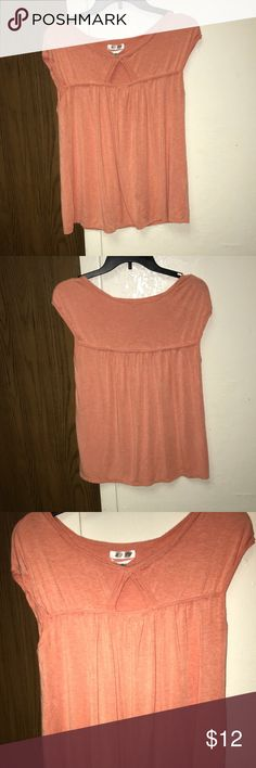 Max Studio Orange Blouse Max Studio Specialty Products medium orange cap sleeve blouse with a small opening on the chest area. Very soft material ! Pair with some shorts or jeans and beige or white shoes. Used/good condition Max Studio Tops Blouses