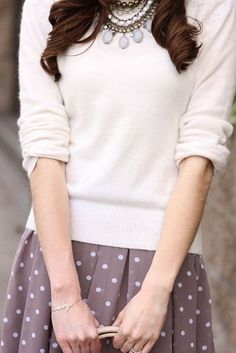 In the winter months, try a crew neck sweater with a printed skirt. Wear the look over a button up shirt for an extra layer or warmth.