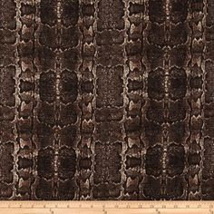 This tweed fabric features a textured python design. With a soft, full bodied drape, this tweed is perfect for creating skirts, coats and jackets.