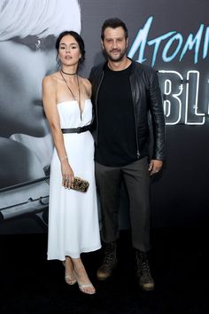 """Actor Stefan Kapicic (R) and guest attend Focus Features' """"Atomic Blonde"""" premiere at The Theatre at Ace Hotel on July 24, 2017 in Los Angeles, California."""