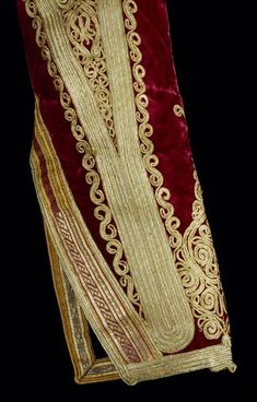 ca. 1810 (made) in Albania The tablet-woven braid that runs diagonally from the upper left towards the lower right of this sleeve is quite astonishing. It is made from many colours of silk thread forming fine stripes and its lower part has been embroidered with metal thread across the width to form more complex patterns. The diagonal opening it decorates is on the under part of the wrist and would not always have been visible, but attention to detail was evidently important.