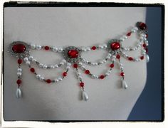 An example of bodice jewelry   Ruby and Pewter Banners Tudor Renaissance by RecycledRockstah, $34.50