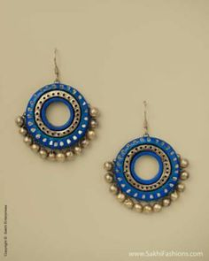Stunning terracotta earrings inspired by the bali or hoop design in soothing blue tone with gold highlights. http://www.sakhifashions.in/at-0016-terra-blue-bali.html