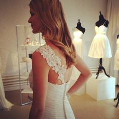 David's Bridal. Love the one-shoulder details!