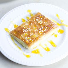 Phyllo wrapped feta cheese with honey and sesame seeds is a favorite Greek cheese appetizer of ours. The perfect combination of phyllo, cheese, honey, and sesame seeds. Greek Appetizers, Cheese Appetizers, Appetizer Recipes, Honey Recipes, Greek Recipes, Tofu Recipes, Empanadas, Enchiladas, Brie