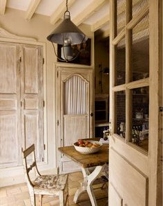 Michele Lalande's unerring touch at Maison-Laffitte. Wood beamed ceiling bleached wood on plaster ceiling. Trim above the cupboard in the wall.