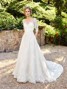 Moonlight Couture H1356B lined bodice wedding gown with long lace sleeves. #bride #modest #wedding #weddingdress #lace