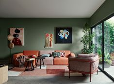 Bohemian-inspired living room with earthy green and orange hues.