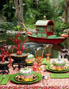 Fantastically Colored Linen for tablecloth, Jim Thompson's Tony Duquette Collection. Custom Venetian glasses. Black lacquer bowls and lotus bowls, all Chinese antiques. Vintage green chargers. Vietnamese wedding boat.