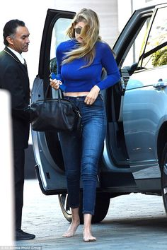 Behind the wheel: Gigi remained shoe-less as she left Joe's house and headed to a hotel on...