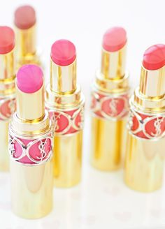 ysl make up beaute ROUGE VOLUPTÉ SHINE pretty good and pink photo of classic iconic lipsticks and Chanel pearls and dish with pink hearts all over! Classic beautiful designer lipstick, one to show off to all your insta-friends!