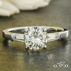 Design Your Own Unique Custom Jewelry at Green Lake Jewelry Works! Custom Platinum solitaire with tapered baguette channel set on the sides