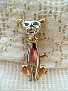 Check out this item in my Etsy shop https://www.etsy.com/listing/201285721/cat-brooch-highly-unusual-lapel-pin