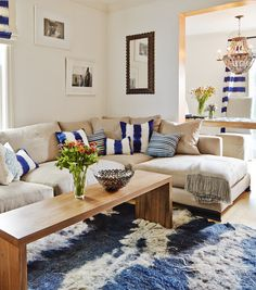 Serene San Francisco living room re-do with throw pillows, accents and decor from Artisan Connect. Love that alpaca throw blanket and those curtains too!