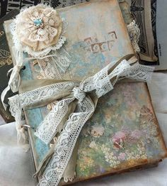 Isn't this notebook to die for.  This is what I imitate my writing books after.  Fabric and ribbon :)
