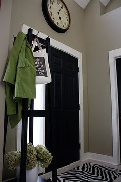 We used 1 x 6 boards for the top of the doors and the baseboards. 1 x 4 boards were used for the vertical door trim pieces. I painted all of the interior doors on the main level black (Martha Stewart ~Silhouette) to contrast with the white trim.
