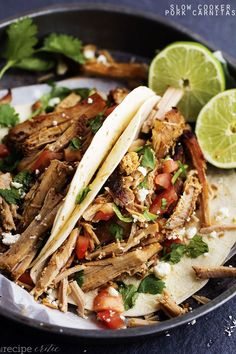 Slow Cooker Pork Carnitas - The easiest slow cooker pork carnitas recipe that is full of flavor and cooks all day to tender and juicy perfection!  A recipe that you will make again and again! If you have been following the blog then it is no secret that I love my slow cooker.  Most