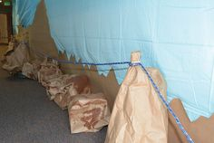 Everest VBS Rope Rail - Paper bags, brown craft paper, paint, and rope combine to create craggy rope railings.