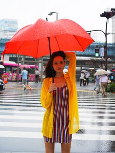 Kalin, employee at our Shibuya Store, is wearing the Barcelona Stripes Tank Dress on a rainy day in Tokyo, Japan.  #aaemployee