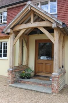 I would love a big beamed oak porch on our cottage - so welcoming