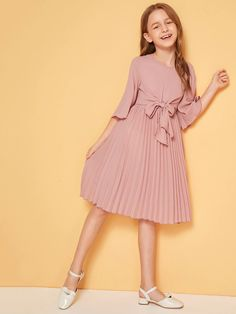 To find out about the Girls Bell Sleeve Tie Front Pleated Dress at SHEIN, part of our latest Girls Dresses ready to shop online today! Girls Dresses Online, Kids Outfits Girls, Little Girl Dresses, Girl Outfits, Girls Fashion Clothes, Kids Fashion, Fashion Dresses, Box Pleated Dress, Tween Mode