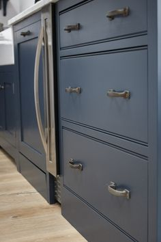 Charlie Kingham South-West London Edwardian House | A traditional kitchen with industrial highlights. A hardwood shaker style kitchen in located in south-west London. Mylands 'Bond Street' Blue hand painted finish, integrated dishwasher, wine cooler and drawers.