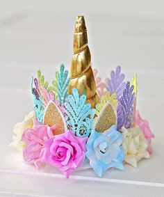 Take a look at this Pastel & Gold Lace Rose-Border Unicorn Crown today!