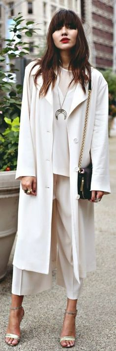 Classic, all white DKNY pantsuit, including oversize trench, matching blouse and culottes.