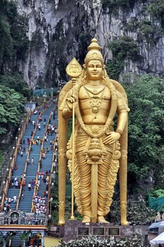 Batu Caves - Malaysia. I survived a steep 272 steps, to get up there. Two more caves up on top with lot of statues and paintings inside. Monkeys everywhere.