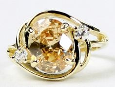 R021, Champagne Cubic Zirconia (CZ), 10KY Gold Ring * Stone Type - Champagne CZ * Approximate Stone Size - 10x8mm  * Approximate Stone Weight - 3.3 cts  * Jewelry Metal - Solid 10k Yellow Gold * Approximate Metal Weight - 3.9 grams  * Ring Size - Size selectable during checkout * Our Warranty - A full year on workmanship  * Our Guarantee - Totally unconditional 30 day guarantee