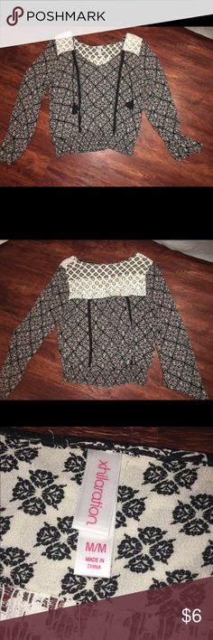 Floral 70's style shirt Only been worn twice and in great condition. The shirt tightens around the waist and the sleeves are flared. Size medium. Tops Blouses