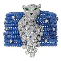 Panthère cuff bracelet, platinum, brilliant-cut diamonds, sapphire beads, sapphire spots, onyx nose, emerald eyes by Cartier