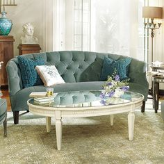 """Amelia 54"""" Oval Coffee Table In Ivory"""