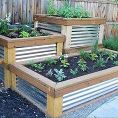 Potager Garden Raised Herb Garden timbers with galvanized metal sides - You will love these amazing Raised Herb Garden Planter Ideas and there is something for everyone. Watch the video tutorial too. Making Raised Garden Beds, Raised Herb Garden, Herb Garden Planter, Building A Raised Garden, Garden Boxes, Raised Beds, Herbs Garden, Fence Garden, Raised Gardens