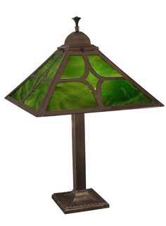 "Mission Table Lamp Diamond Shade with Art Glass. $374.40. Two brass pull chain sockets are operated separately with a polarized plug. The brass shade frame is the classic ""J"" or diamond design, originating with Sechrist of Colorado between 1910 - 1920.This is made of top quality brass, darkened to an ""antique"" finish.  The base contains a heavy cast iron load to maintain stability. We offer matching ceiling lights, table lamps, and sconces in three art glass colors."