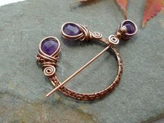 https://www.etsy.com/listing/168467431/penannular-brooch-woven-copper-and Gorgeous amethyst & copper brooch, inspired by Viking & Celtic styles.
