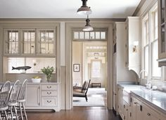 love all the transom windows and the bar/pass-thru area {Victoria Hagan Interiors}