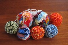 More colourful pompoms to hang on the icord.