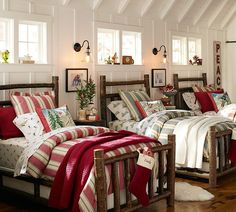 I just love this picture - log beds and Christmas decor.  I can smell the cocoa and hear the Christmas music now. :)