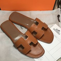 b9a5158a4ec7 Hermes slippers leather slides brown