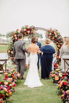 Outdoor summer wedding ceremony decor with colorful flowers and round arch - Bohemian Road Photography | Colorful Wedding Flowers Pop Agains Teal Bridesmaid Dresses Floral Wedding, Wedding Colors, Wedding Bouquets, Wedding Flowers, Wedding Dresses, Teal Bridesmaid Dresses, Dream Wedding, Wedding Day, Bridal Salon