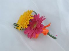 Bright gerbera double buttonhole - A White Hot Wedding