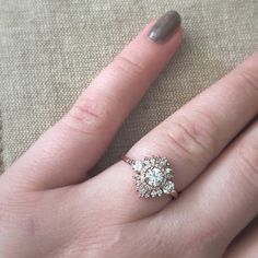 My custom three-stone Gatsby Petite ring from Heidi Gibson. Heidi used the three center stones from my grandmother's wedding ring to make this special piece. www.heidigibson.com