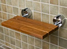 Wall mounted folding teak shower bench for bathroom. teak wood shower bench has many functions. To elderly or families who suffer from standing during a shower, this teak bench really helps them. Bathroom Renos, Bathroom Furniture, Small Bathroom, Bathroom Ideas, Bathroom Laundry, Bathroom Stuff, Bathroom Towels, Bathroom Remodeling, Modern Bathroom