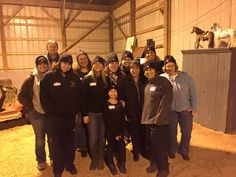 Getting our picture taken with all of the volunteers wearing the Mustard Seed's hat we got for free during the program.