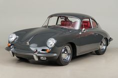 1963 Porsche Carrera 2 Coupe by Reutter VIN: 120351 The Carrera 2 was an amazing advancement when it arrived in 1961, and the most expensive car Porsche had ever built. The star of the show was the jewel of an engine that resided in the back of the car: a two-liter, quad-cam masterpiece that put …
