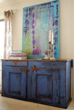 Amazing color grouping. Love the old blue cupboard paired with this fabulous painting