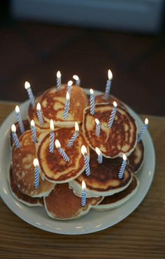 Breakfast birthday party pancake cake with candles. YUM