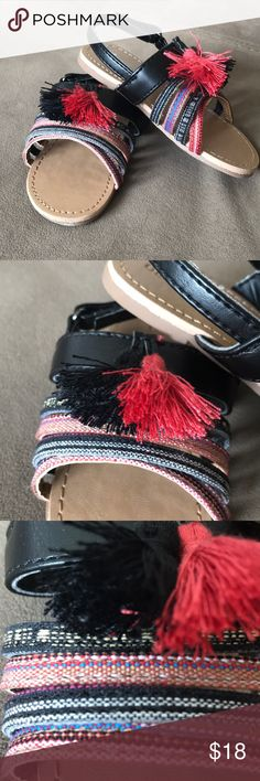 🎈Old Navy stripe/tassel black multi 7 sandals 🎈These are the CUTEST Old Navy stripe/tassel black multi 7 sandals truly adorable with Velcro straps for easy in and out. NWOT never worn! VERY STYLISH! And hey go with everything!!! Old Navy Shoes Sandals & Flip Flops